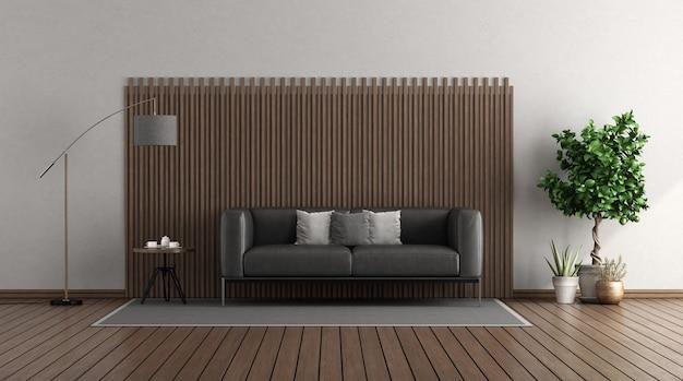 Soggiorno moderno con divano in pelle nera davanti a un pannello di legno