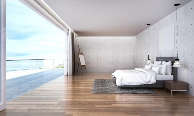 Il moderno design degli interni della camera da letto in soppalco e lo sfondo con vista sul mare