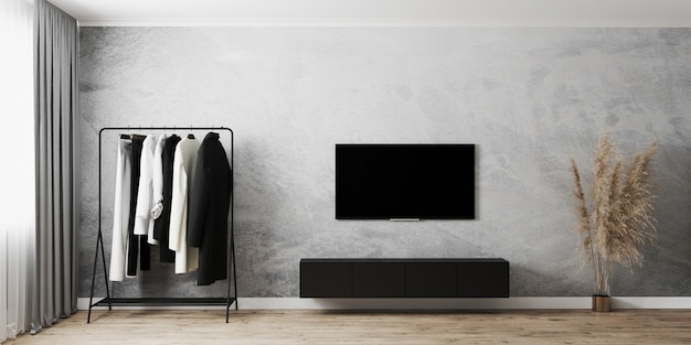 Interiore della stanza moderna con appendiabiti, tv con armadi neri, muro di cemento grigio e pavimento in legno