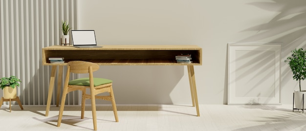 Interno scandinavo moderno del posto di lavoro nell'ufficio domestico con lo spazio della copia e del computer portatile sulla tavola di legno