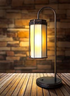 Lampada elettrica moderna in acciaio e tessuto su tavolo in legno e muro di mattoni