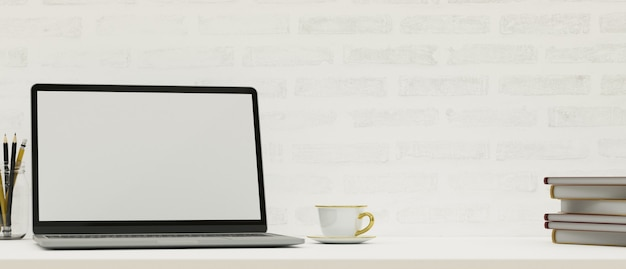 Area di lavoro moderna con lo spazio della copia del modello del computer portatile sulla rappresentazione bianca del muro di mattoni 3d della tavola bianca