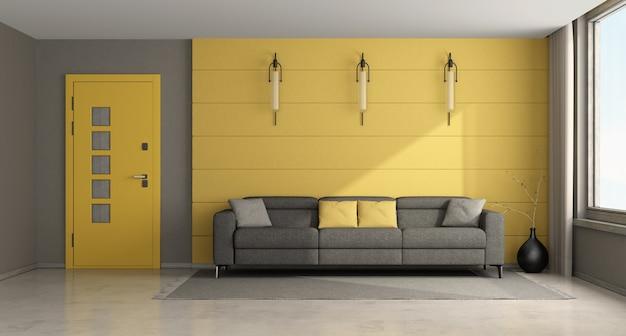 Soggiorno moderno giallo e grigio con divano e porta d'ingresso