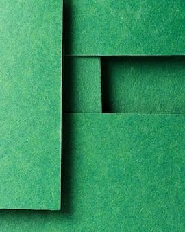 Assortimento monocromatico di nature morte con carta verde