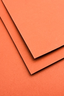 Assortimento monocromatico di nature morte con carta arancione