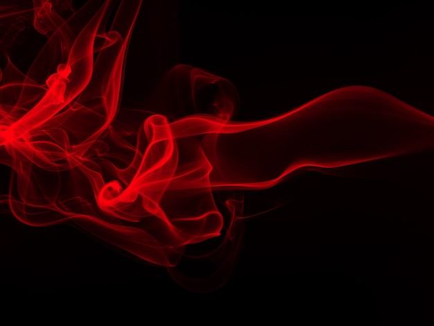 Movimento di fumo rosso astratto su sfondo nero, fuoco disign