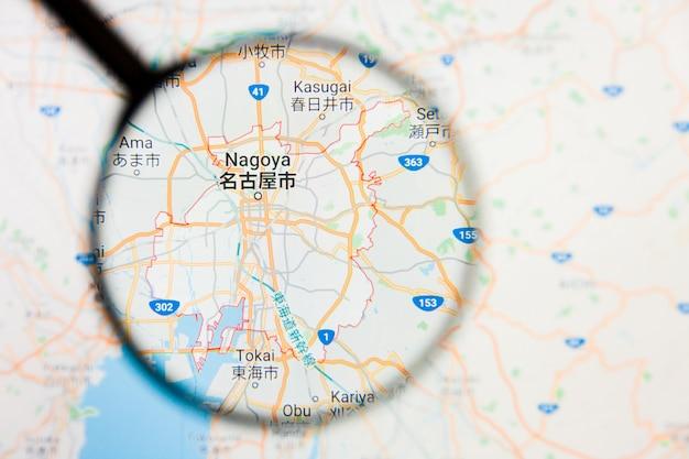 Concetto illustrativo di visualizzazione della città di nagoya, giappone sullo schermo di visualizzazione tramite la lente d'ingrandimento