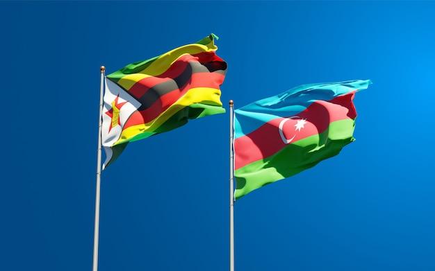 Bandiere di stato nazionali dello zimbabwe e dell'azerbaigian insieme