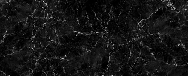 Trama di marmo nero naturale per sfondo lussuoso di carta da parati di piastrelle di pelle, per opere d'arte di design. design di fondale per interni in ceramica artistica in pietra. marmo ad alta risoluzione
