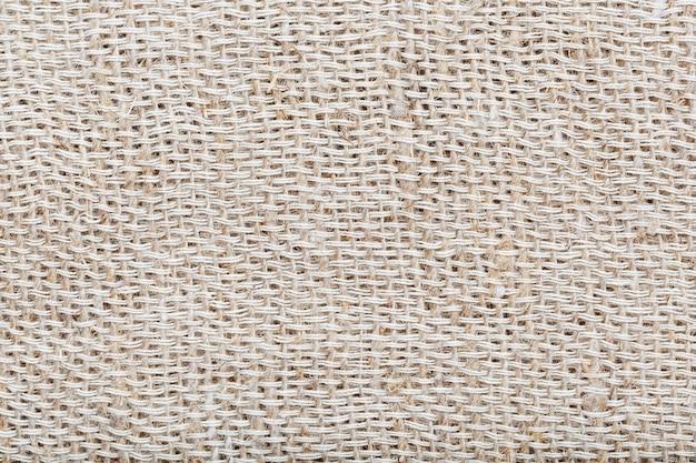 Tessuto di tela naturale con fibre come sfondo.