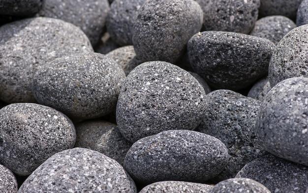 Colori naturali delle rocce vulcaniche dal monte merapi a yogyakarta, indonesia, per lo sfondo.