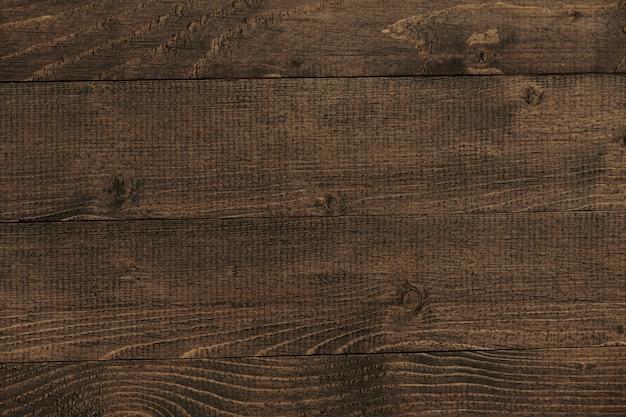 Sfondo di plancia di legno scuro naturale, tavole come sfondo astratto con spazio vuoto come modello, struttura in legno