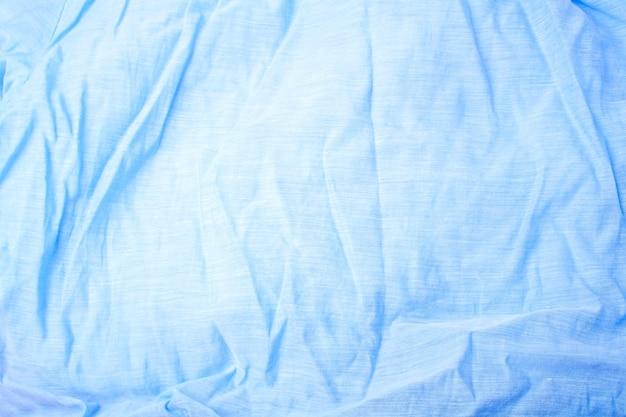 Tessuto blu delicato naturale. stile piatto
