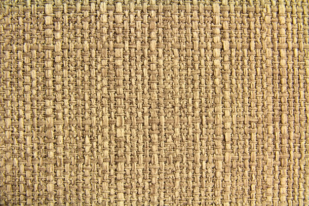 Trama di lino in tessuto naturale per il design, tela strutturata. tela marrone. cotone.