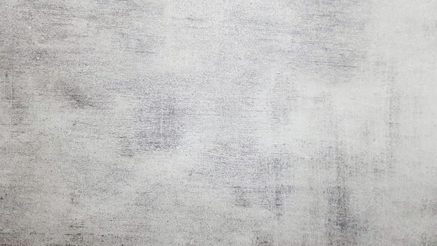 Motivo di sfondo in pietra ardesia grigia naturale. vista dall'alto. copia spazio. piastrella con una tinta grigia. trama e sfondo senza soluzione di continuità.