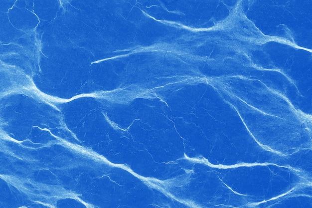 Motivo naturale di marmo blu il motivo e la trama dello sfondo di pietra