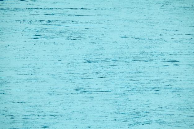 Fondo in compensato naturale verniciato blu in tinta unita con pennellate, nuovo e pulito