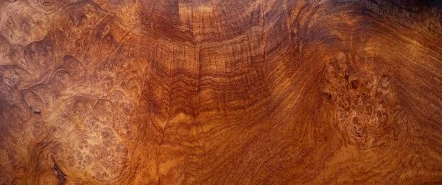Il legno di radica di afzelia naturale a strisce è un bellissimo motivo in legno per artigianato o sfondo