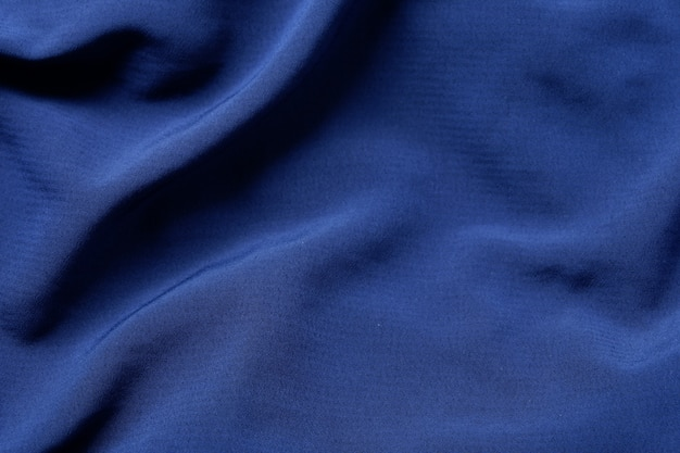 Fondo di struttura del tessuto di colore blu marino