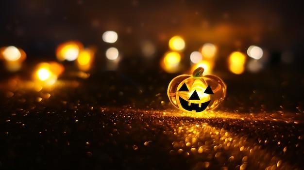 Testa di zucca incandescente al neon su sfondo bokeh sfocato astratto. sfondo festivo di halloween