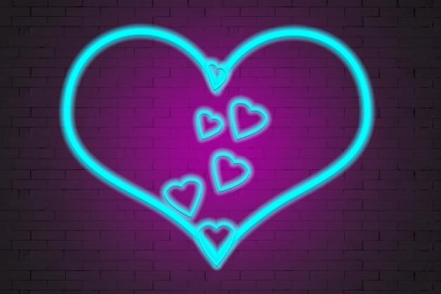 Cuori al neon su uno sfondo di muro di mattoni.