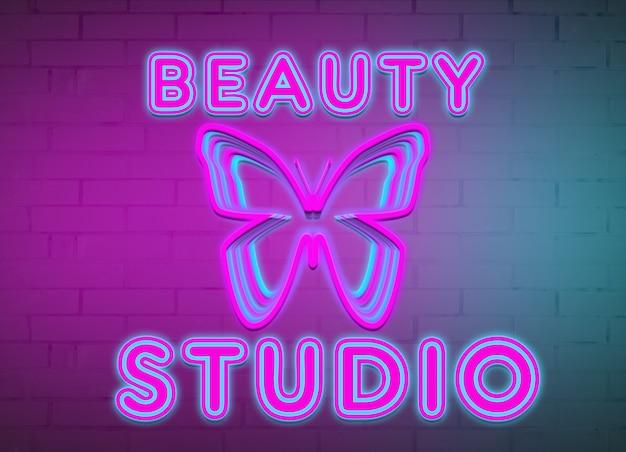 Salone di bellezza e farfalla dell'iscrizione al neon sullo sfondo di un muro di mattoni.