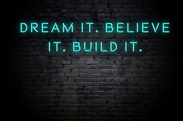 Iscrizione al neon della citazione motivazionale saggia positiva contro il muro di mattoni