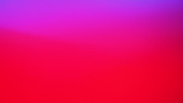 Sfondo di colore chiaro rosso e viola al neon. sfondo sfumato astratto sfocato. modello di bandiera.