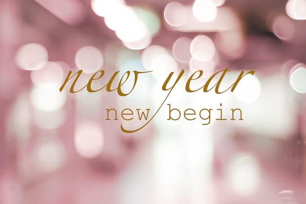 Nuovo anno nuovo inizio, citazione positiva del nuovo anno su sfocatura luci astratte
