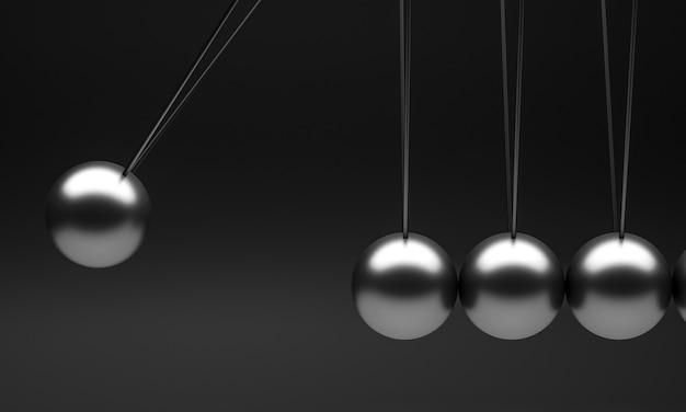 Newton pendolo culla su uno sfondo nero.