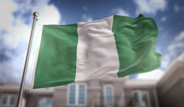 Bandiera della nigeria rendering 3d sullo sfondo del cielo blu