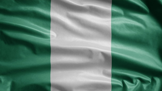Bandiera nigeriana che fluttua nel vento. close up nigeria modello che soffia, seta morbida e liscia. priorità bassa del guardiamarina di struttura del tessuto del panno. usalo per il concetto di occasioni nazionali e di campagna