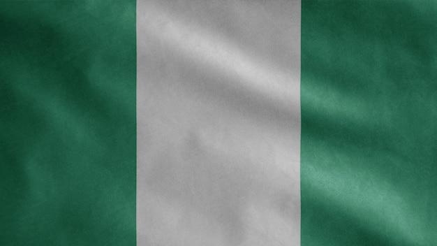 Bandiera nigeriana che fluttua nel vento. close up nigeria modello che soffia, seta morbida e liscia.