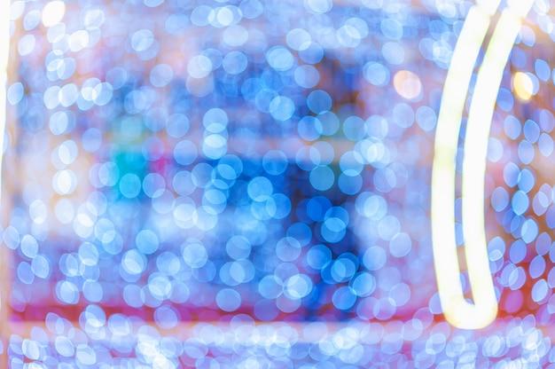 Luce notturna in città bokeh colorato sfondo astratto sfocatura riflesso lente riflesso bellissimo glitter