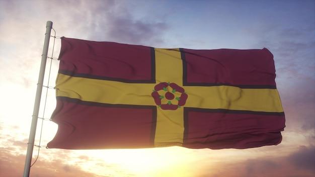Bandiera del northamptonshire, inghilterra, che fluttua nel vento, nel cielo e nello sfondo del sole. rendering 3d