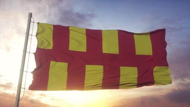 Bandiera del northumberland, inghilterra, che fluttua nel vento, nel cielo e nello sfondo del sole. rendering 3d
