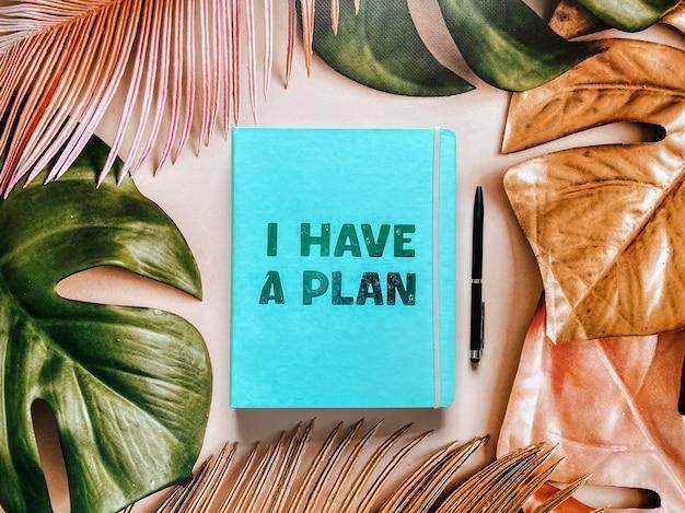 Agenda per notebook con la scritta ho un piano su un bellissimo sfondo estivo tropicale.