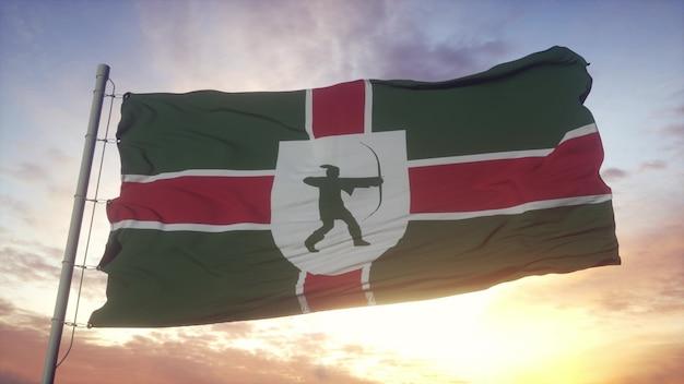Bandiera del nottinghamshire, inghilterra, che fluttua nel vento, nel cielo e nello sfondo del sole. rendering 3d.