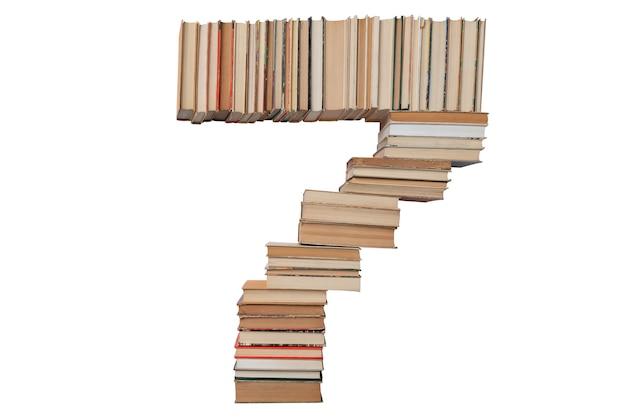 Numero 7 di libri isolati su bianco