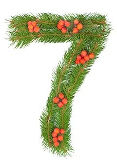 Numero sette fatto di rami di abete dell'albero di natale