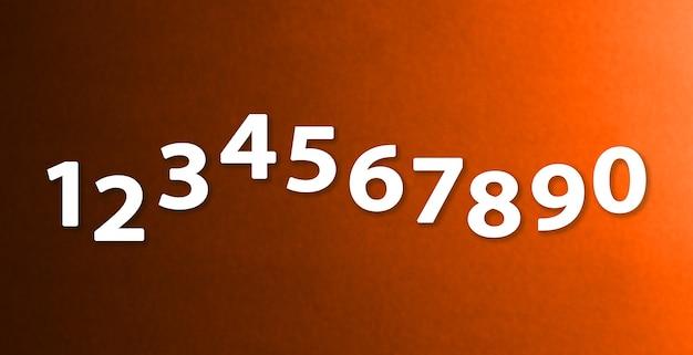I numeri da zero a nove su sfondi di carta di colore diverso.