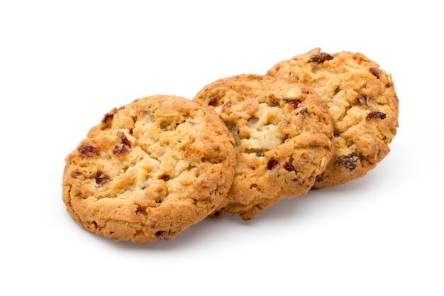 Biscotti di farina d'avena con mirtilli rossi su una superficie bianca.