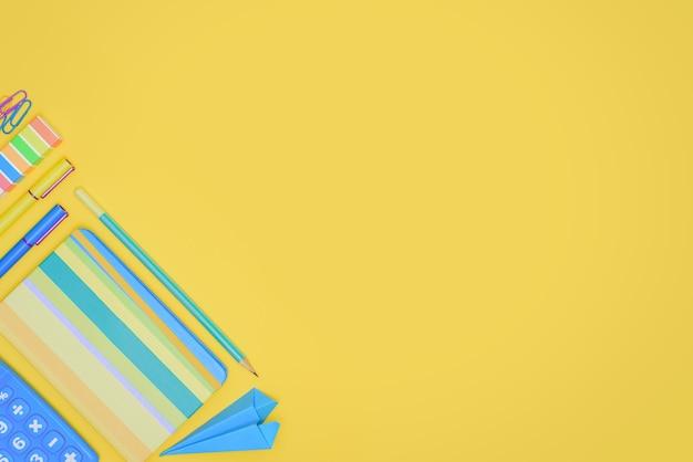 Forniture per ufficio su sfondo giallo