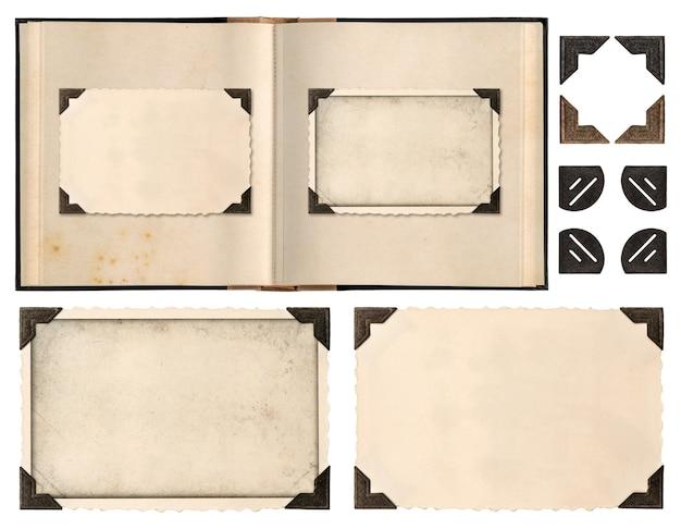Vecchia pagina del libro dell'album con cornici per foto e angoli isolati su sfondo bianco