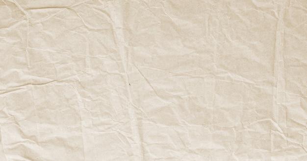 Vecchia carta da imballaggio stropicciata beige, trama di carta kraft, vintage, retrò