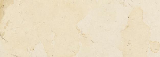 Vecchia trama beige di carta vintage a macchie e striature con una copia dello spazio e dello spazio per il testo