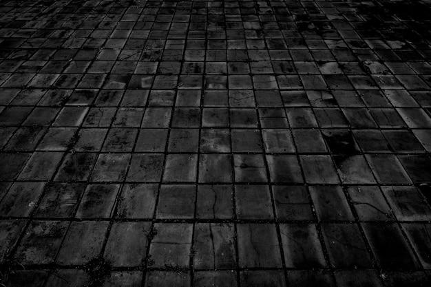 Vecchio fondo di struttura del pavimento di mattoni neri.