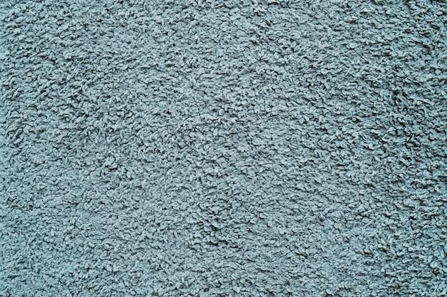 Vecchio tappeto blu per fondo e struttura.