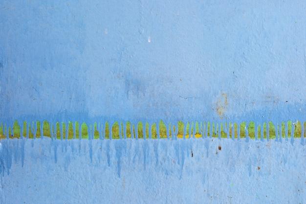 Una vecchia trama di sfondo del muro di cemento blu