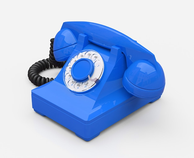 Vecchio telefono con linea blu su una superficie bianca